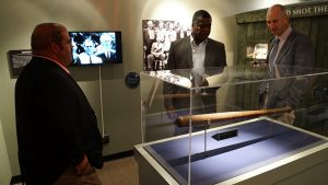 'Eddie joins guests in the new American Hercules gallery.' from the web at 'http://baberuthmuseum.org/wp-content/uploads/2015/09/DSC00567-300x169.jpg'