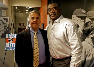 '105.7 The Fan's Scott Garceau (left) joined us to lead an up-close-and-personal question and answer session with Eddie Murray (right).' from the web at 'http://baberuthmuseum.org/wp-content/uploads/2015/09/DSC00738-300x214.jpg'