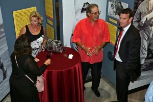 'Guests enjoy wine tasting in the 1st floor Babe Ruth: 100 exhibition gallery.' from the web at 'http://baberuthmuseum.org/wp-content/uploads/2015/09/DSC00751-300x200.jpg'