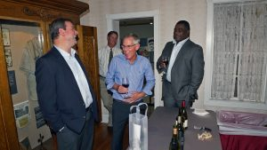 'Board Member Bruce Gearhart (center), head of Bacchus Importers, provided the signature wine for the evening.' from the web at 'http://baberuthmuseum.org/wp-content/uploads/2015/09/DSC00775-300x169.jpg'