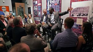 'Scott Garceau and Eddie Murray regale the crowd with stories from Murray's life and career.' from the web at 'http://baberuthmuseum.org/wp-content/uploads/2015/09/DSC00884-300x169.jpg'